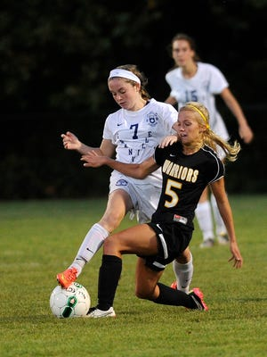 Watkins Memorial's Amberly Knox battles a Granville player for possession during a match earlier this season. The Warriors visit Lancaster at 7 p.m. Tuesday to open Division I tournament play.