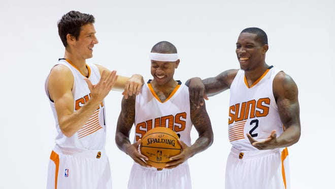 Suns guards Goran Dragic (left), guard Isaiah Thomas and guard Eric Bledsoe pose for a portrait during media day on Sept. 29, 2014 at the US Airways Center.