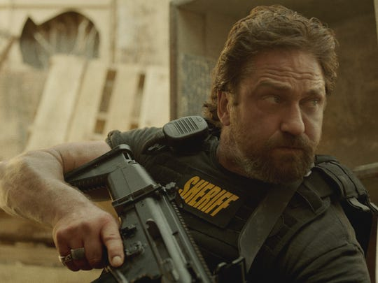 """Gerard Butler leads a no-holds-barred unit of the Los Angeles County Sheriff's Department in """"Den of Thieves."""""""
