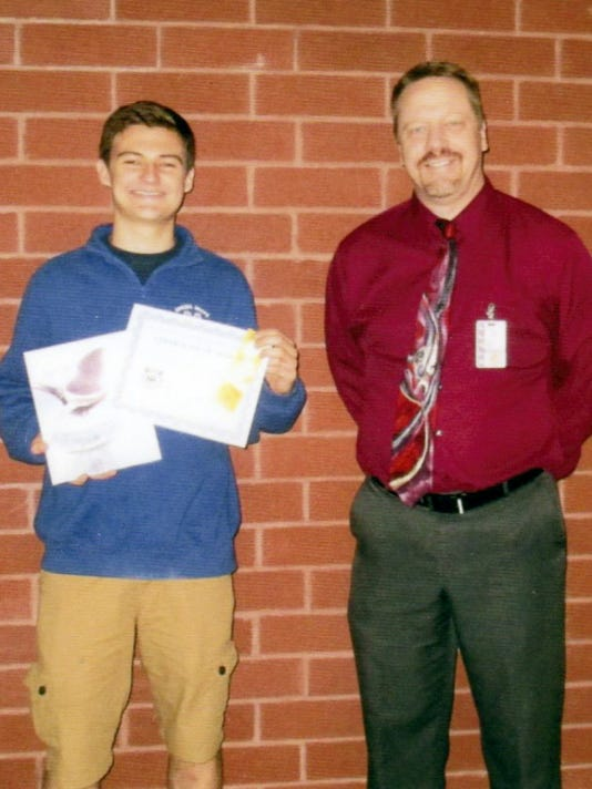 Ian Coble, left, won third place in the Women's Club of Spring Grove Art Contests, in the category of color photography (grades 9-12). Coble is pictured alongside art instructor Troy Smith.