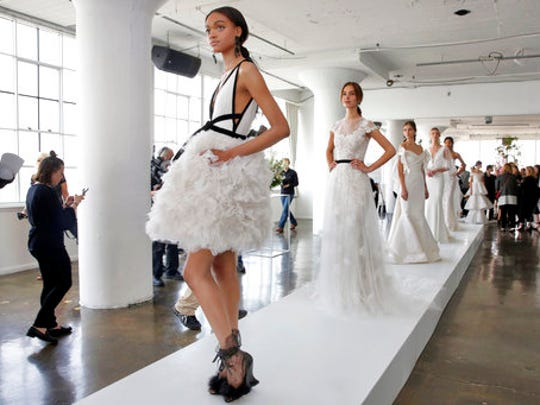 In this April 20, 2017 photo, the Marchesa bridal collection is presented during bridal fashion week in New York.