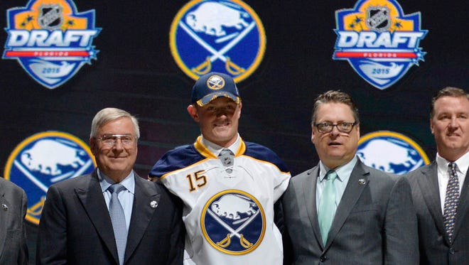 Jack Eichel poses with team executives after being selected as the number two overall pick to the Buffalo Sabres in the first round of the 2015 NHL Draft at BB&T Center.