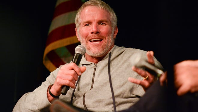 Brett Favre recounts anecdotes from his playing days at the 3rd annual Chalk Talk to benefit Rawhide Boys Ranch at KI Convention Center in downtown Green Bay.