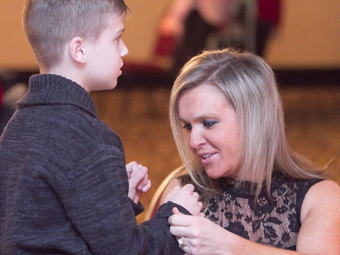 8-year-old Brady Hunter and his mom Jackie attend the