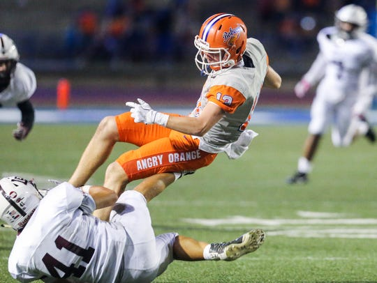 Centrall's Philip Lupton is tackled by Midland Lee