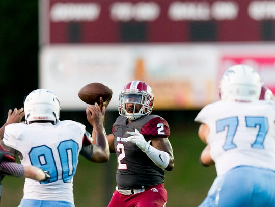 Oak Ridge's Johnny Stewart (2) looks for a pass during