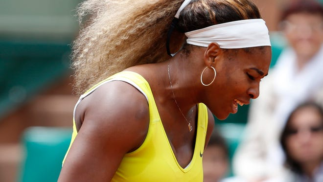 Serena Williams after missing a return during the second round match against Spain's Garbine Muguruza.