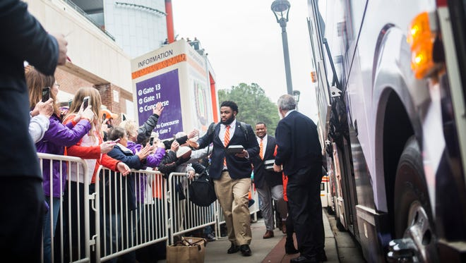 Clemson's expenses in its quest for the national championship include the football team's travel to Tampa, Florida, which began Friday with a bus trip from the university to Greenville-Spartanburg International Airport.