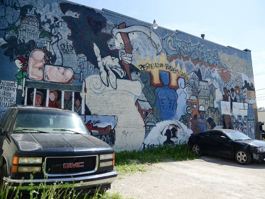The mural along a wall of Creative Visions in the King