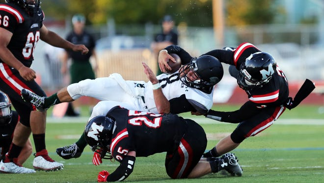 Cade Smith is tackled as West Salem travels to McMinnville in their opening high school football of the season.