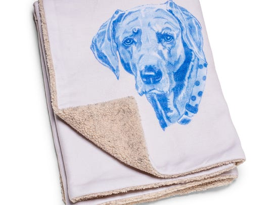 This blanket can be customized with your pet's picture at charlesfradinhome.com.