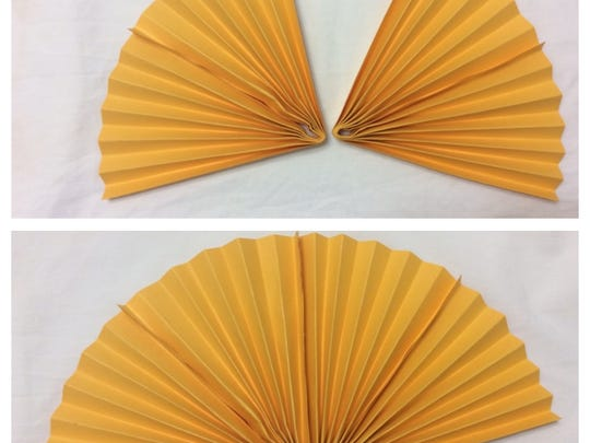 Fold the paper, then glue the two pieces together to make a fan.