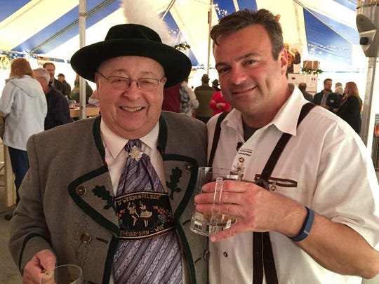 Eric enjoys a beer with Frank, an Oktoberfest regular.