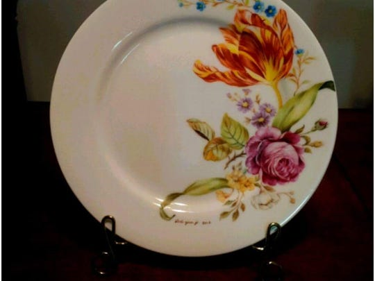 Artist Younji Doh has hand-painted porcelain on display at the Ridgewood Library.