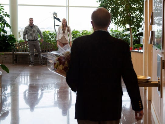 George Liberatore walks into a meeting with Brittany
