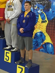 CR's Michael Clavier on the podium after his 7th-place finish in the 195-pound weight class at the Beast of the East wrestling tournament.