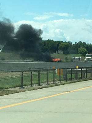 A car caught fire on I-90 near mile marker 397 in Sioux Falls on Friday.