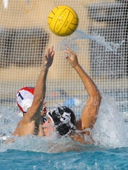 Ryan Oleson of Xavier Prep, makes a hook pass during