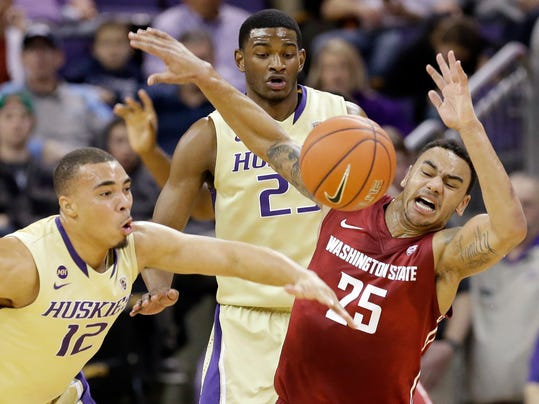 Washington's Andrew Andrews (12) knocks the ball away from Washington State's DaVonte Lacy (25) for a turnover in the first half of an NCAA college basketball game Friday, Feb. 28, 2014, in Seattle. (AP Photo/Elaine Thompson)