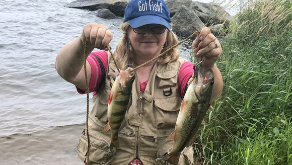 Carol battled the wind to hook a fat perch and a bass