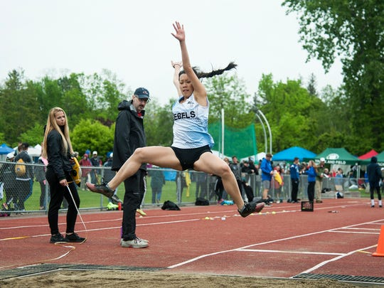 South Burlington's Katherine Yang competes in the long jump during the division I high school track and field state championships at Burlington High School on Saturday June 3, 2017 in Burlington. (BRIAN JENKINS/for the FREE PRESS)