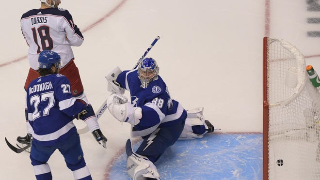 Pierre-Luc Dubois scores on a deflection that gets past Lightning goaltender Andrei Vasilevskiy in the first period Tuesday.