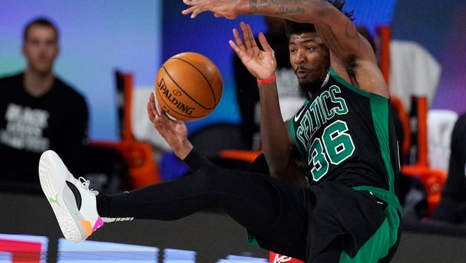 The Celtics' Marcus Smart was named to the NBA All-Defensive Team's first team for the second year in a row.