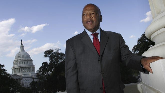 In this Oct. 10, 2007, file photo, with the Capitol Dome in the background, U.S. Rep. John Lewis, D-Ga., is seen on Capitol Hill in Washington. Lewis, who carried the struggle against racial discrimination from Southern battlegrounds of the 1960s to the halls of Congress, died Friday, July 17, 2020.