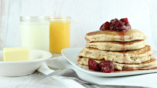 Start your day with pancakes topped with home-grown strawberries.