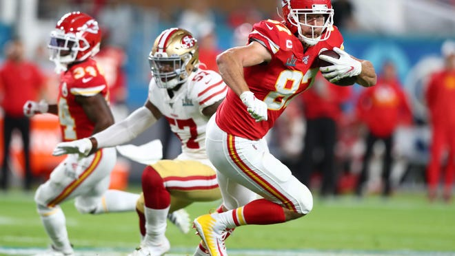 Kansas City Chiefs tight end Travis Kelce runs with the ball after a first-quarter reception against the San Francisco 49ers in Super Bowl LIV on Feb. 2 at Hard Rock Stadium in Miami Gardens, Fla. [Mark J. Rebilas/USA Today Sports