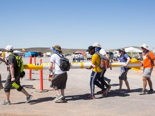 The Rowan University rocket team walks their rocket to a registration area, Friday June 22, 2018 at the Spaceport America Cup.