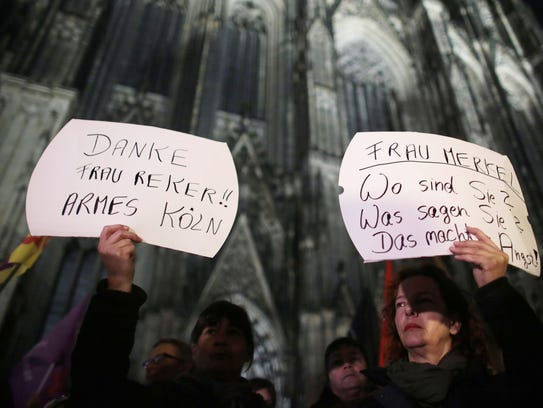 Women protest against sexism outside the cathedral