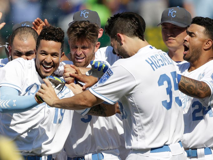 Kansas City Royals' Cheslor Cuthbert (19) celebrates