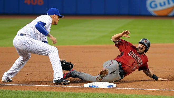 Aug 23, 2017; New York City, NY, USA; Arizona Diamondbacks center fielder A.J. Pollock (11) slides safely into third base ahead of a tag by New York Mets third baseman Wilmer Flores (4) during the first inning at Citi Field. Mandatory Credit: Brad Penner-USA TODAY Sports