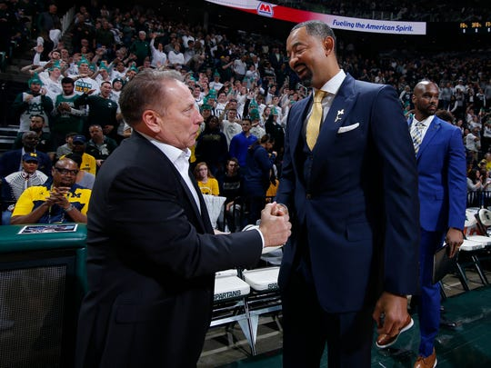 Michigan State coach Tom Izzo, left, and Michigan coach Juwan Howard greet each other before an NCAA college basketball game, Sunday, Jan. 5, 2020, in East Lansing, Mich. Michigan State won 87-69. (AP Photo/Al Goldis)