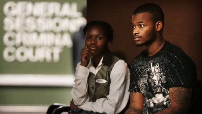 Davonte Weatherford (right), who was shot by a police officer in September in Frayser, waits outside court with Jameshia Isaac before a hearing on charges of aggravated assault, theft of property and evading arrest.