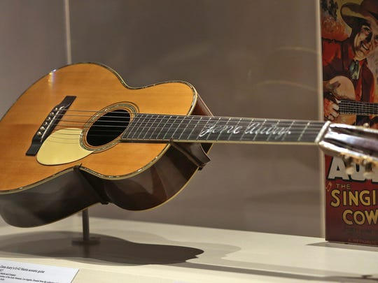 """This is Gene Autry's O-42 Martin 1927 acoustic guitar, seen in The Reel West exhibit at the Eiteljorg Museum, Thursday, March 1, 2018.  The exhibit, which runs Mar. 3, 2018 to Feb. 3, 2019, looks at """"morality, diversity, and American identity,"""" seen through the Western film genre, Hollywood movies, and television shows. Autry was one of the most successful to come out of the """"singing cowboy genre."""""""