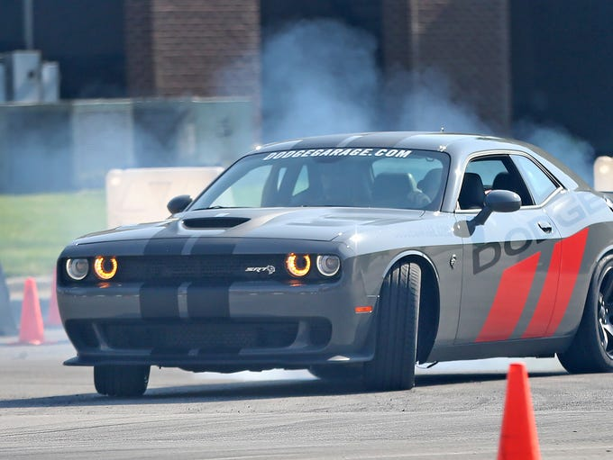 Professional drivers drive car enthusiasts for a free