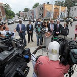 Tawanda Jones, center, speaks after hearing of a judge's decision of acquittal on all charges for Lt. Brian Rice, one of the six members of the Baltimore Police Department charged in connection to the death of Freddie Gray, in Baltimore on July 18, 2016.