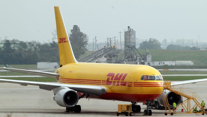 Workers prepare a DHL plane for take off at the company's hub near  Cincinnati/Northern Kentucky International Airport in October.