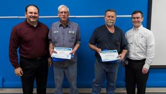 Pictured are Gibbs Die Casting 45-year Service Award Recipients: Marvin Mattingly and Brad Owen. Joining them to celebrate are John Economou, COO (far left) and Steve Church, President & CEO (far right).