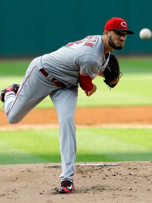 Cincinnati Reds starting pitcher Tim Adleman delivers in the first inning of a baseball game against the Cleveland Indians, Monday, July 24, 2017, in Cleveland. (AP Photo/Tony Dejak)
