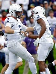 Penn State quarterback Tommy Stevens, left, celebrates