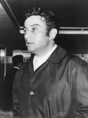 Comedian Lenny Bruce at New York's Idlewild Airport in  1963.