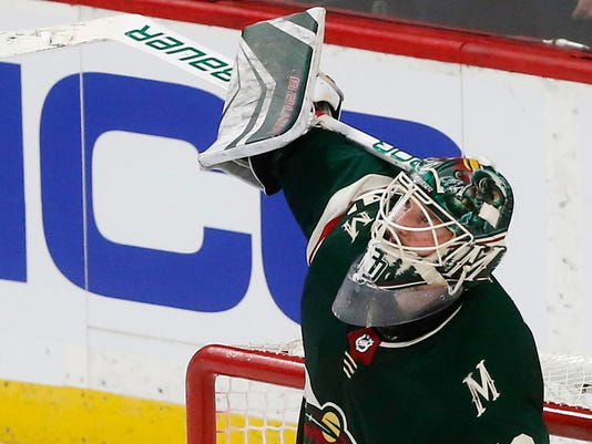 Minnesota Wild goalie Devan Dubnyk celebrates his team's win over the Vegas Golden Knights in an NHL hockey game Friday, Feb. 2, 2018, in St. Paul, Minn. (AP Photo/Jim Mone)