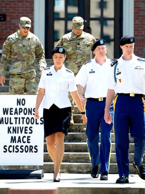 U.S. Army Sgt. Robert Bowdrie 'Bowe' Bergdahl (right), 30 of Hailey, Idaho, leaves the Ft. Bragg military courthouse with his military counsel, Capt. Nina Banks and Lt. Col. Franklin D. Rosenblatt, during a recess in a pretrial military hearing on July 7, 2016 at Ft. Bragg, N.C.