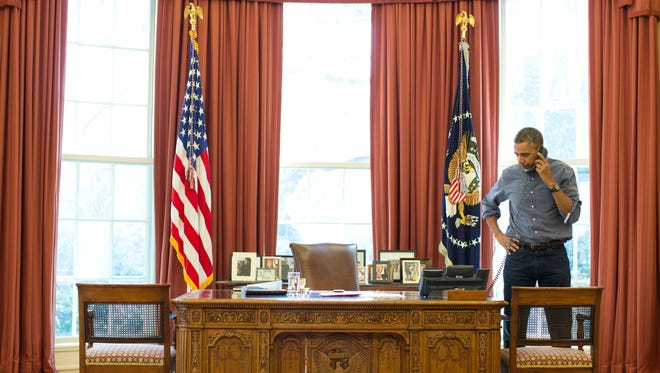President Obama talks on the phone in the Oval Office with Russian President Vladimir Putin on Saturday.