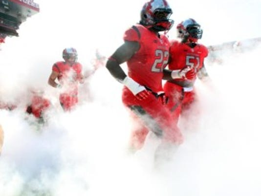 Rutgers football players run out of the tunnel at High Point Solutions Stadium prior to last week's game against Howard. (Mark Sullivan/Staff photographer)