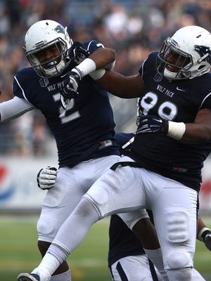 Nevada's Asauni Rufus, left, celebrates with Korey Rush after recording an interception against Hawaii in 2015.