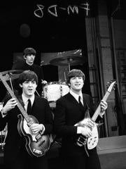 From left, Paul McCartney, Ringo Starr and John Lennon